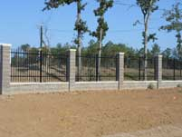 Wrought Iron Fence with Stone Columns