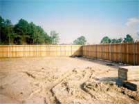 Commercial Wood Privacy Fence w/Barbwire Top